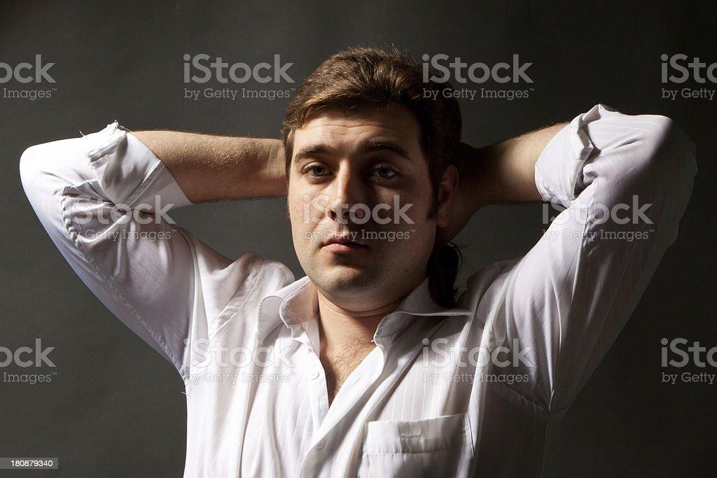 man posing in white shirt on dark background royalty-free stock photo