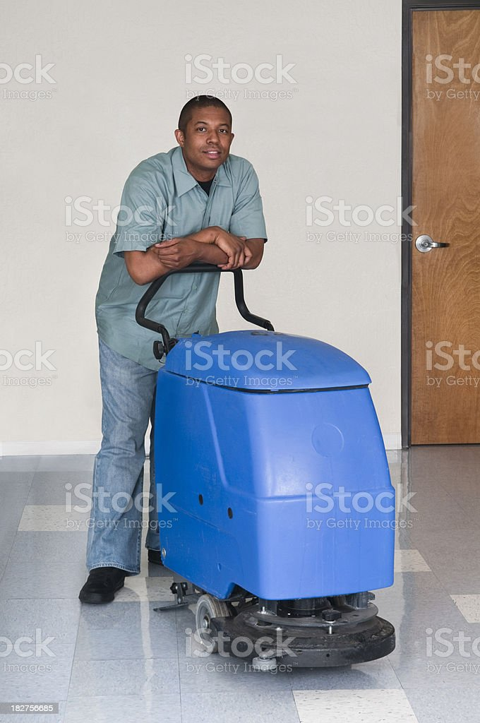Man Posing While Cleaning an Office - Janitorial Services Series stock photo