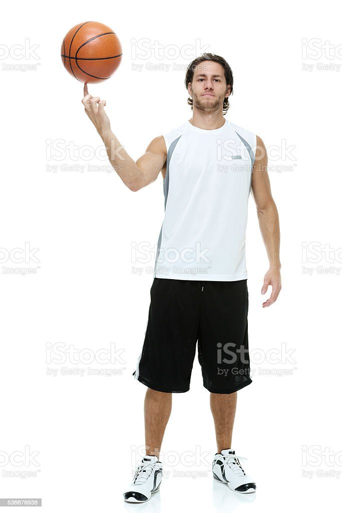 Man posing with basketball stock photo