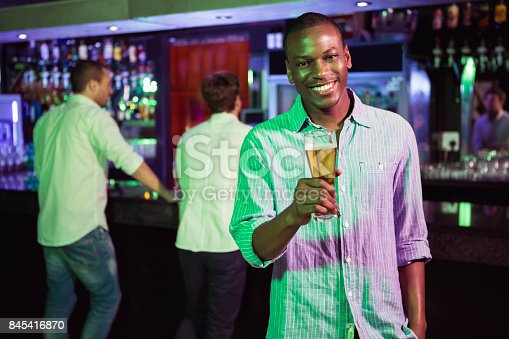 istock Man posing with glass of beer 845416870