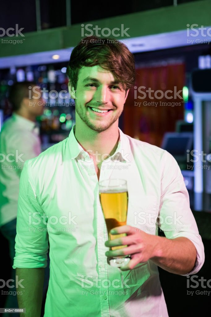 Man posing with glass of beer stock photo