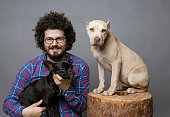 Man posing with his pets