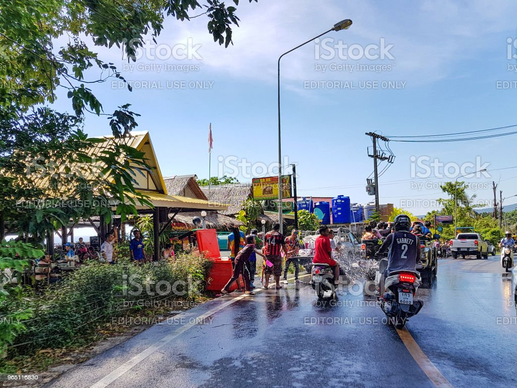 Man pour water on motorbike driver celebrate traditional Thai New Year - Songkran Festival zbiór zdjęć royalty-free