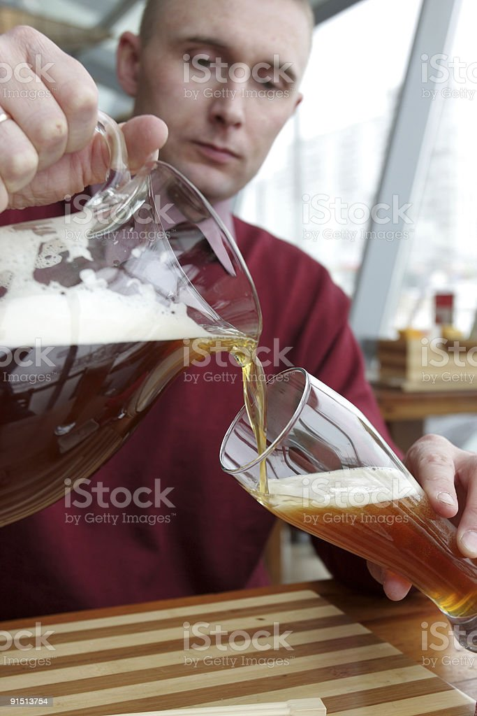 Man pouring beer stock photo