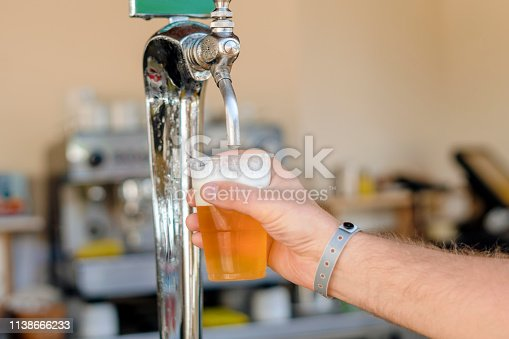 istock Man pouring fresh beer in self service bar - with all inclusive badge 1138666233