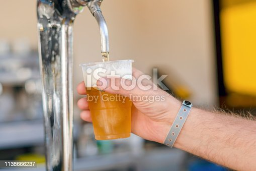 istock Man pouring fresh beer in self service bar - with all inclusive badge 1138666237