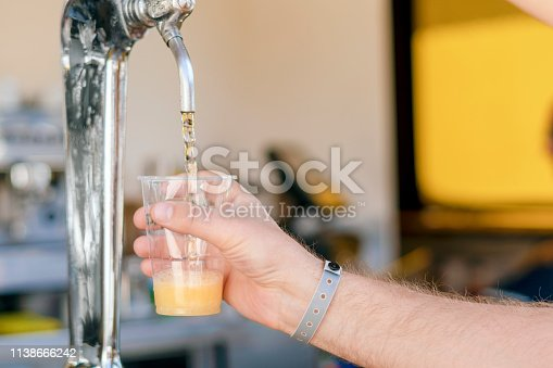 istock Man pouring fresh beer in self service bar - with all inclusive badge 1138666242