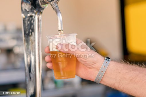 istock Man pouring fresh beer in self service bar - with all inclusive badge 1138666243