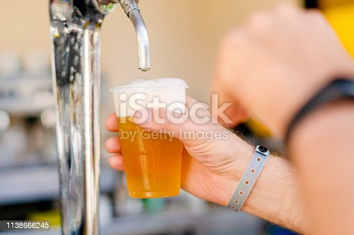 istock Man pouring fresh beer in self service bar - with all inclusive badge 1138666245