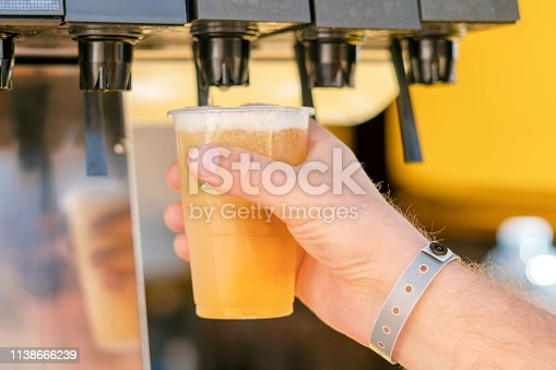 istock Man pouring fresh drink in self service bar 1138666239