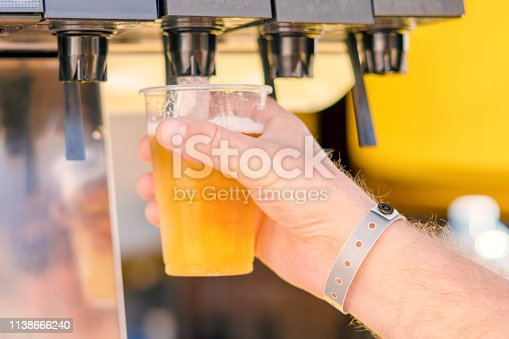 istock Man pouring fresh drink in self service bar 1138666240