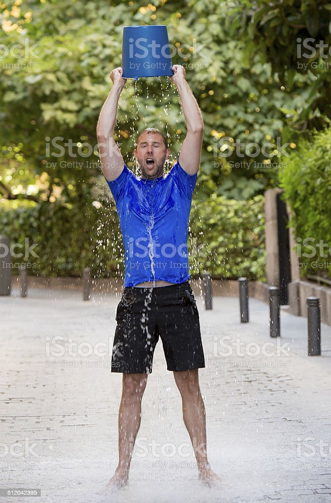 man pouring ice bucket on internet viral media campaign stok fotoğrafı