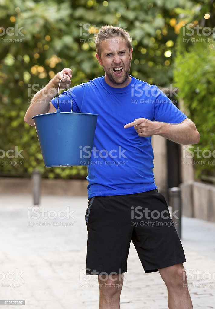 man pouring ice bucket on internet viral media campaign stock photo