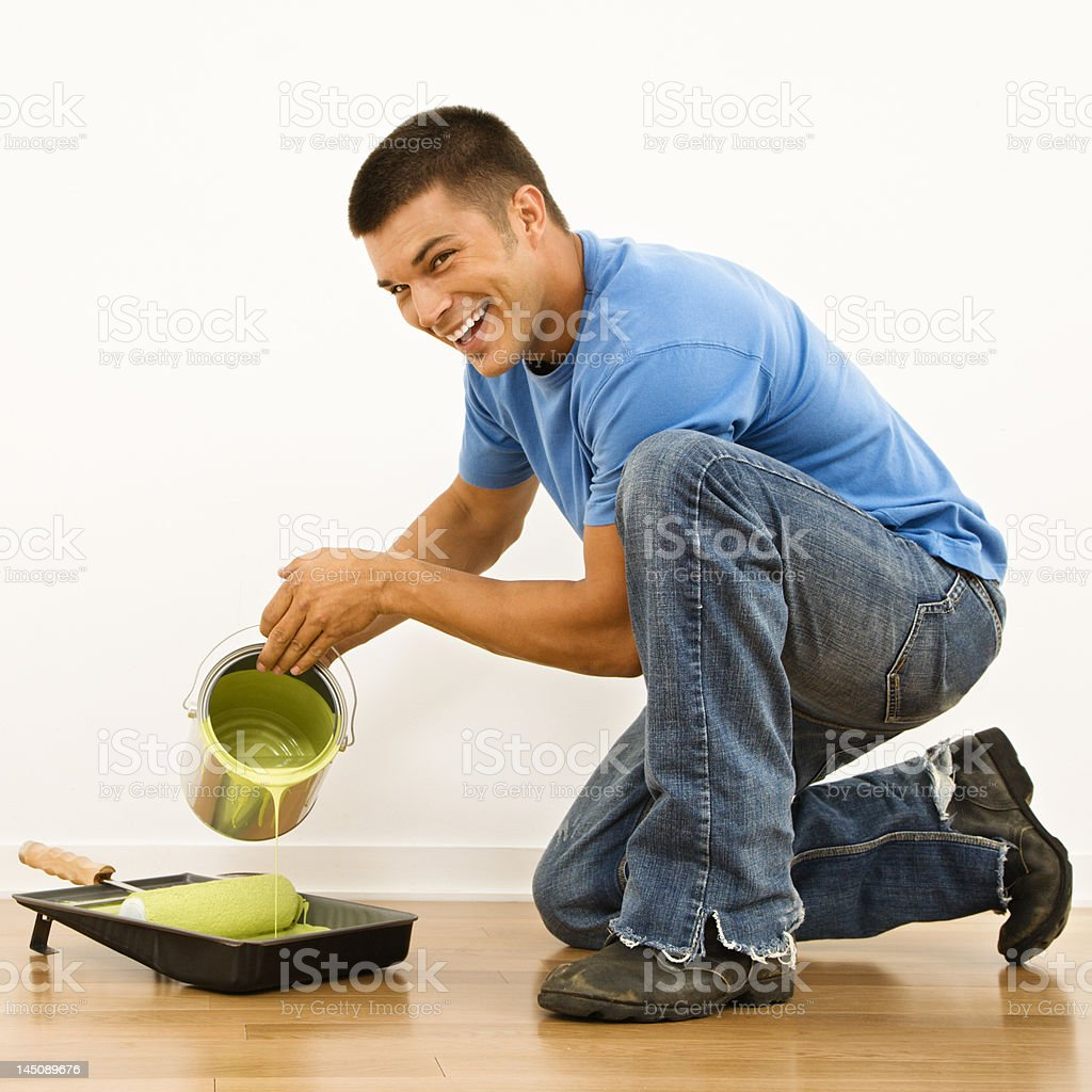 Man pouring paint. royalty-free stock photo