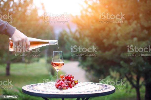 Man pouring rose wine to the glass in autumn vineyard on marble table picture id1131576222?b=1&k=6&m=1131576222&s=612x612&h=dtmwzstcqtbctixxh4qu59y57czictm7trgv6mcbjfg=