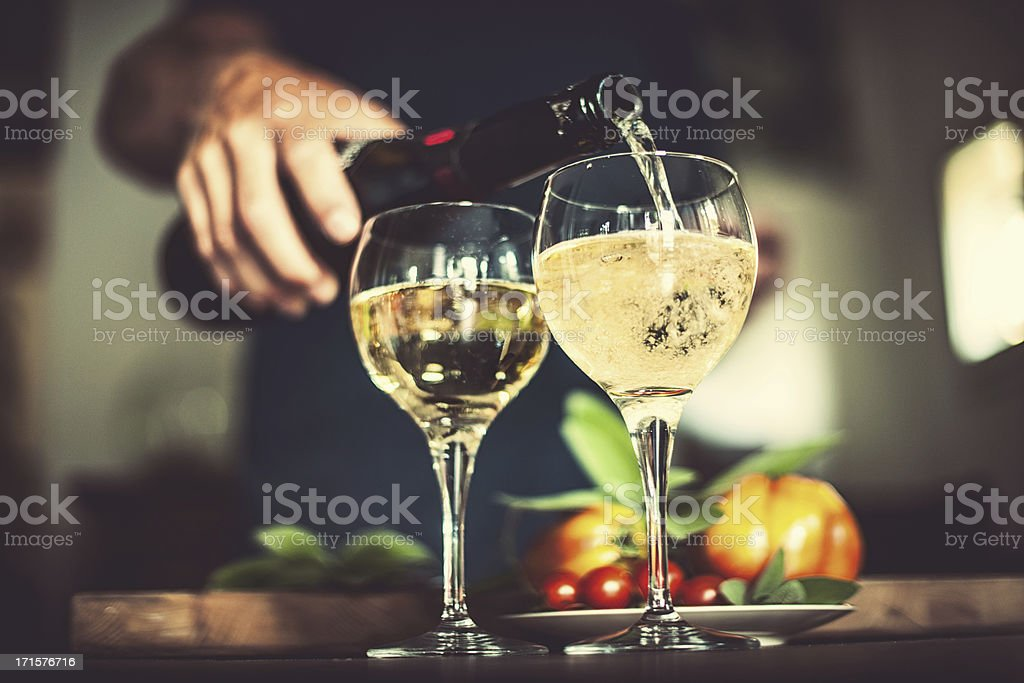 Man pouring sparkling wine stock photo