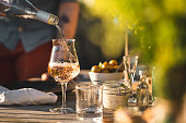 istock Man pouring up rose wine at midsummer dinner 1237689569