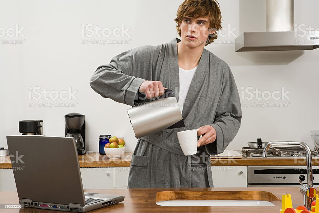 A man pouring water from a kettle 免版稅 stock photo