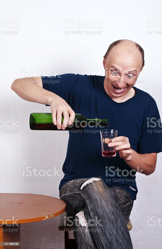 Man pouring wine in glass royalty-free stock photo