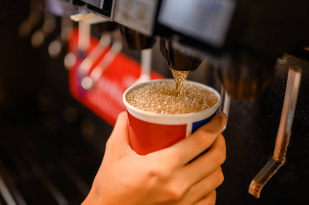 man pours a fizzy drink.sparkling water.cool ice soft drink cola man pours a fizzy drink.sparkling water.cool ice soft drink cola machinery stock pictures, royalty-free photos & images
