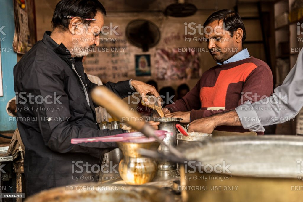 Man Pours Cup Hot Milk Tea Masala Chai Indian Style Royalty Free Stock