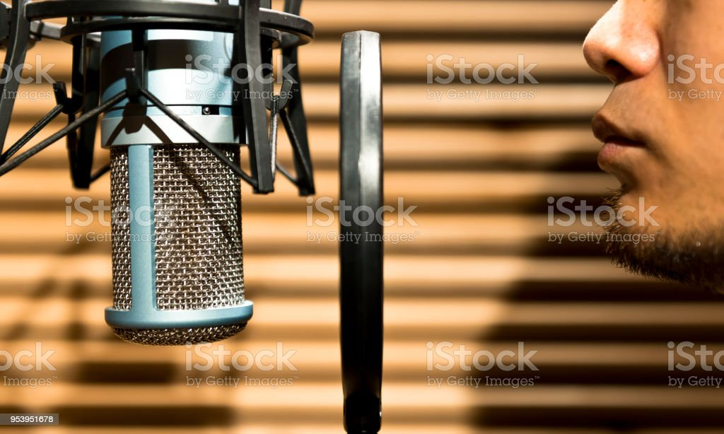 A man practices singing in the studio room stock photo
