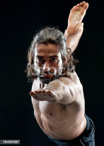 511849865istockphoto Man practicing hot yoga 184304597