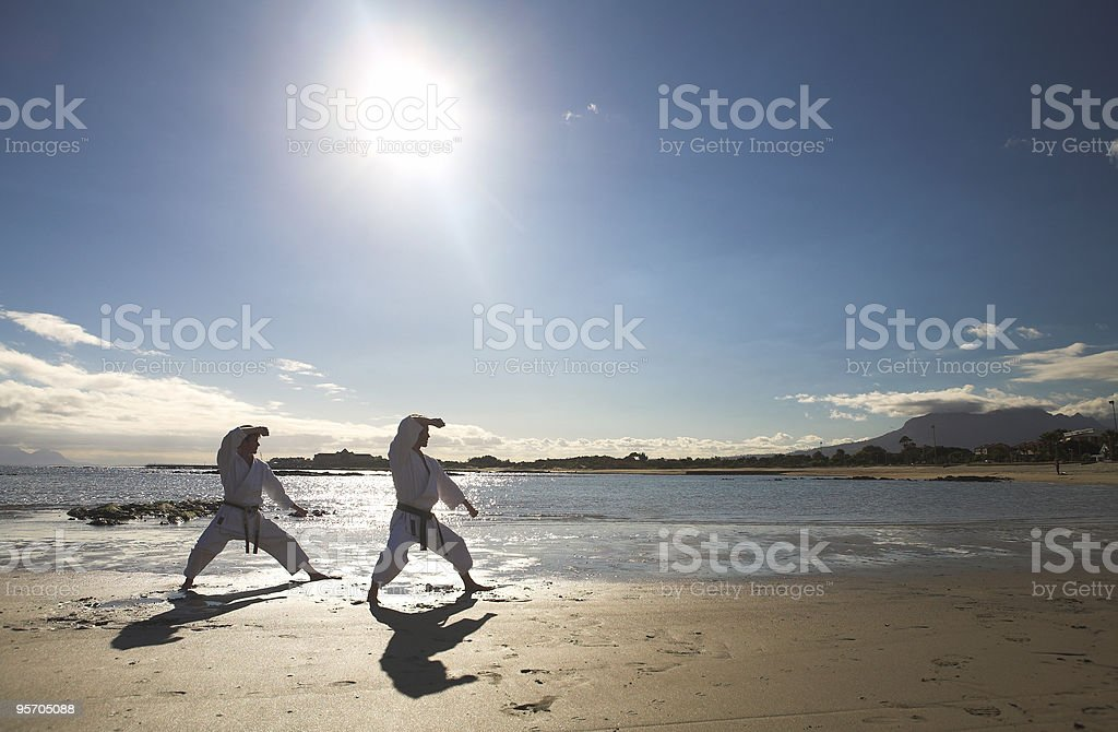 Man practicing Karate on the beach royalty-free stock photo