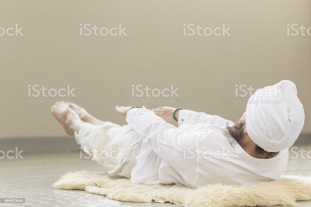 Man Practicing Kundalini Yoga And Bow Pose Stock Photo