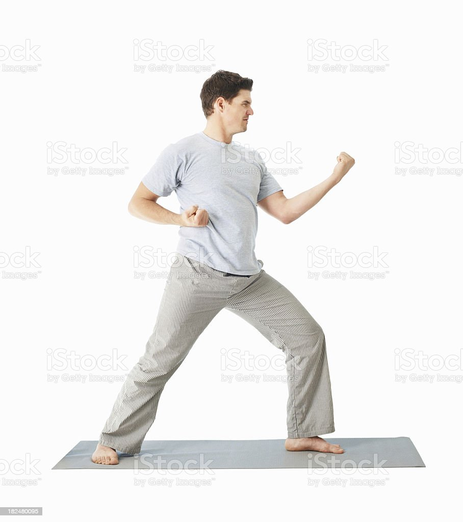 Man practicing martial arts over white background royalty-free stock photo