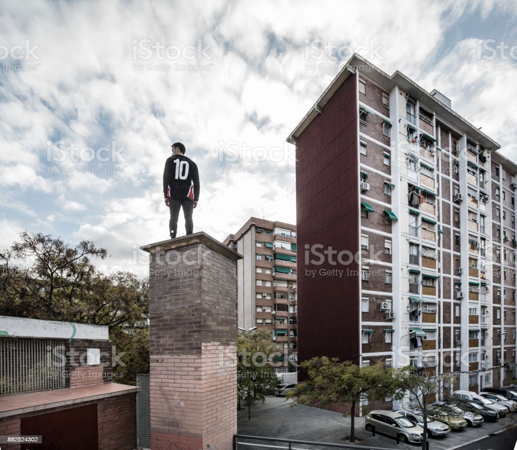 Young man practicing parkour in the city in Sant Ildefons Cornella de...
