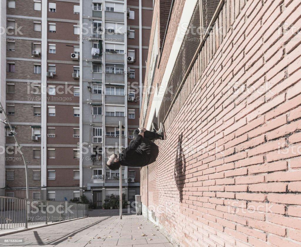 Man practicing parkour in Cornella de Llobregat Catalonia Spain