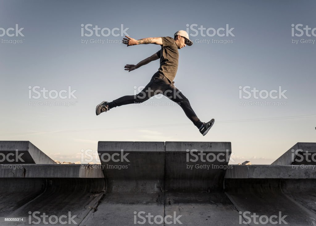 Man practicing parkour in the city stock photo