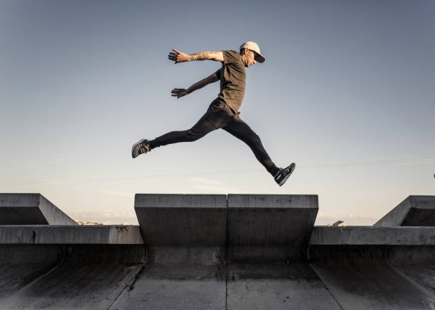Man practicing parkour in the city Young man practicing free running in the city agility stock pictures, royalty-free photos & images