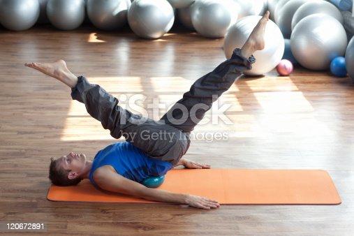 istock Man practicing pilates 120672891