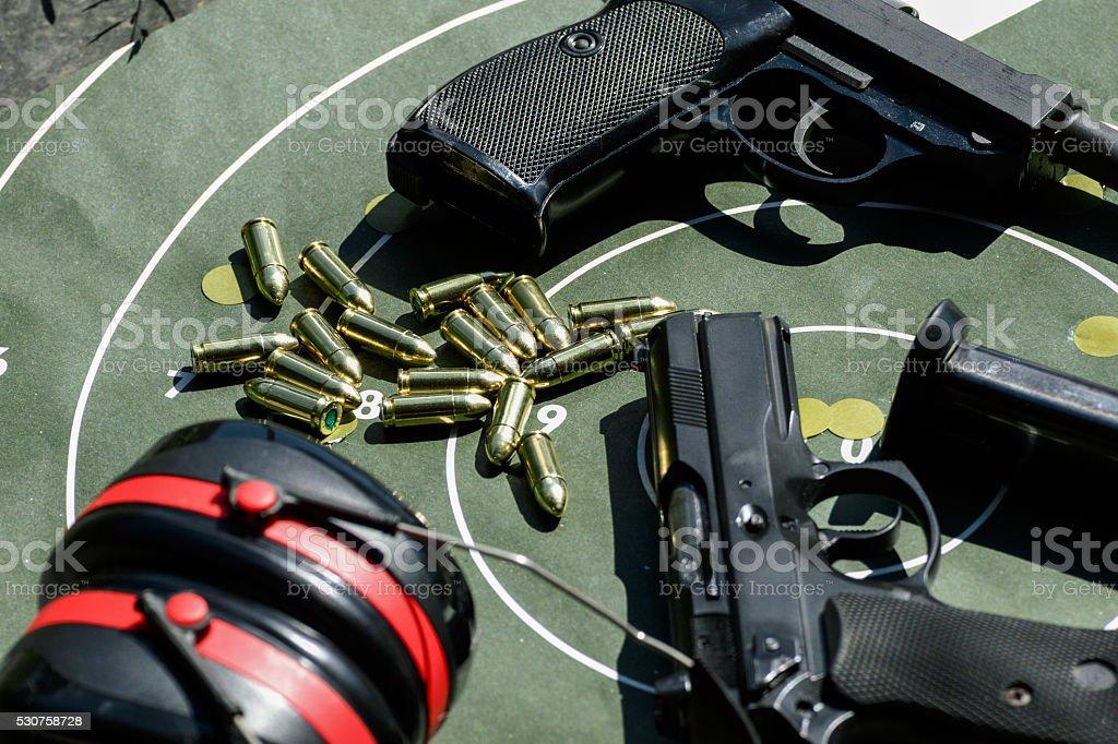 Man practicing shooting with a gun stock photo