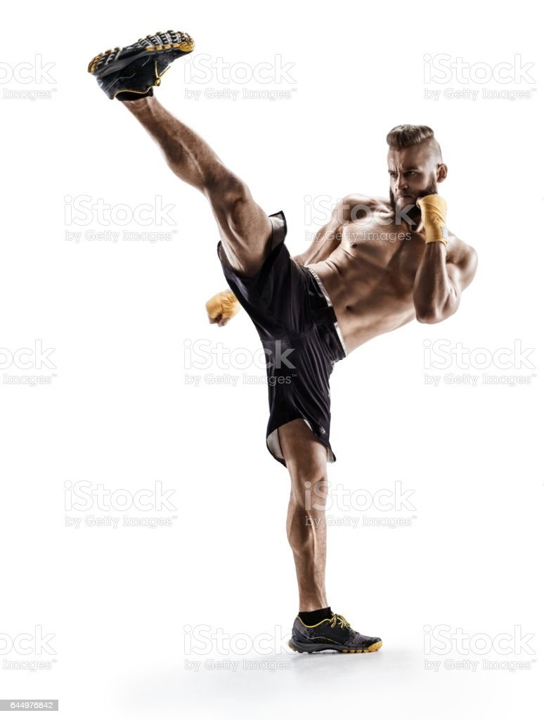 Man practicing tae-bo exercises, kicking forward with legs. royalty-free stock photo