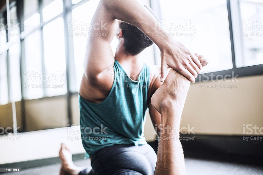 Man Practicing Yoga in Bright Studio royalty-free stock photo
