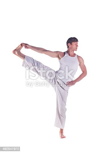 Man practicing yoga doing the
