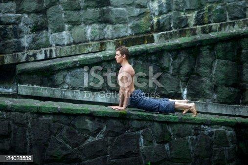 511849865istockphoto man practing yoga outdor 124028539