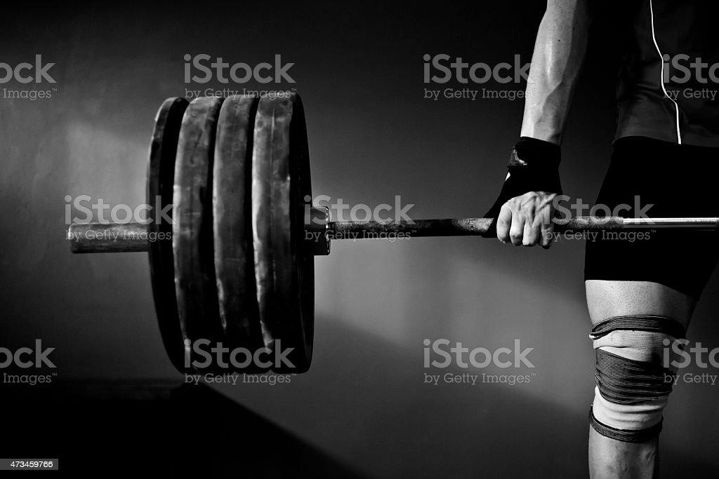 Man practising weightlifting stock photo