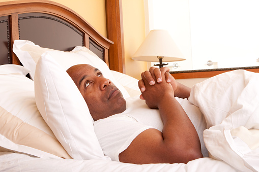 Man Praying Before Bed Stock Photo Amp More Pictures Of