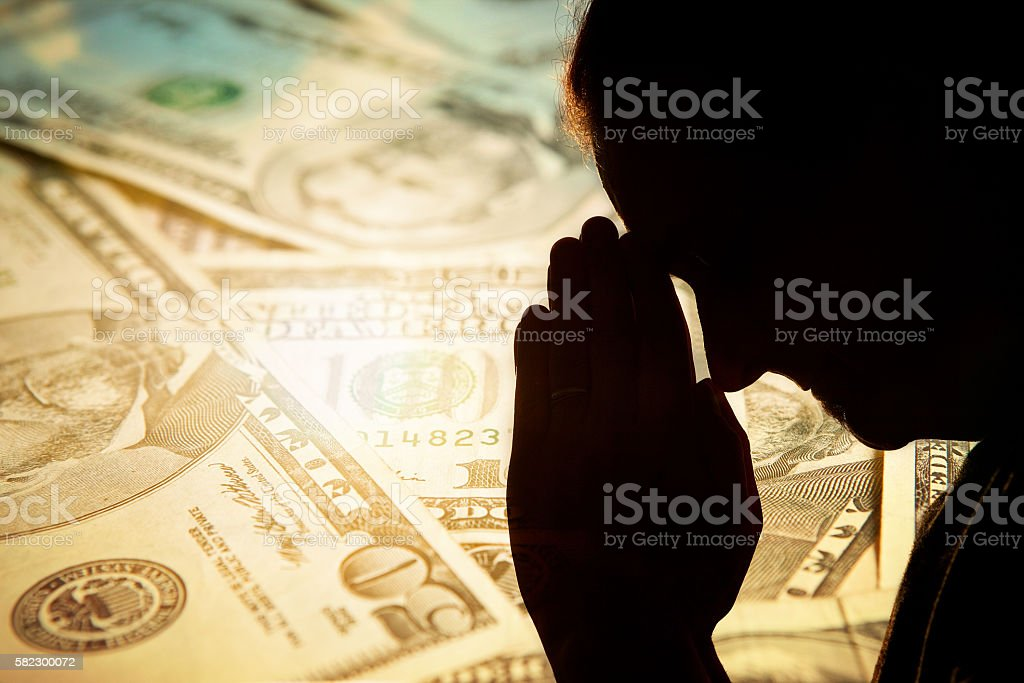 Man Praying For Money Concept stock photo