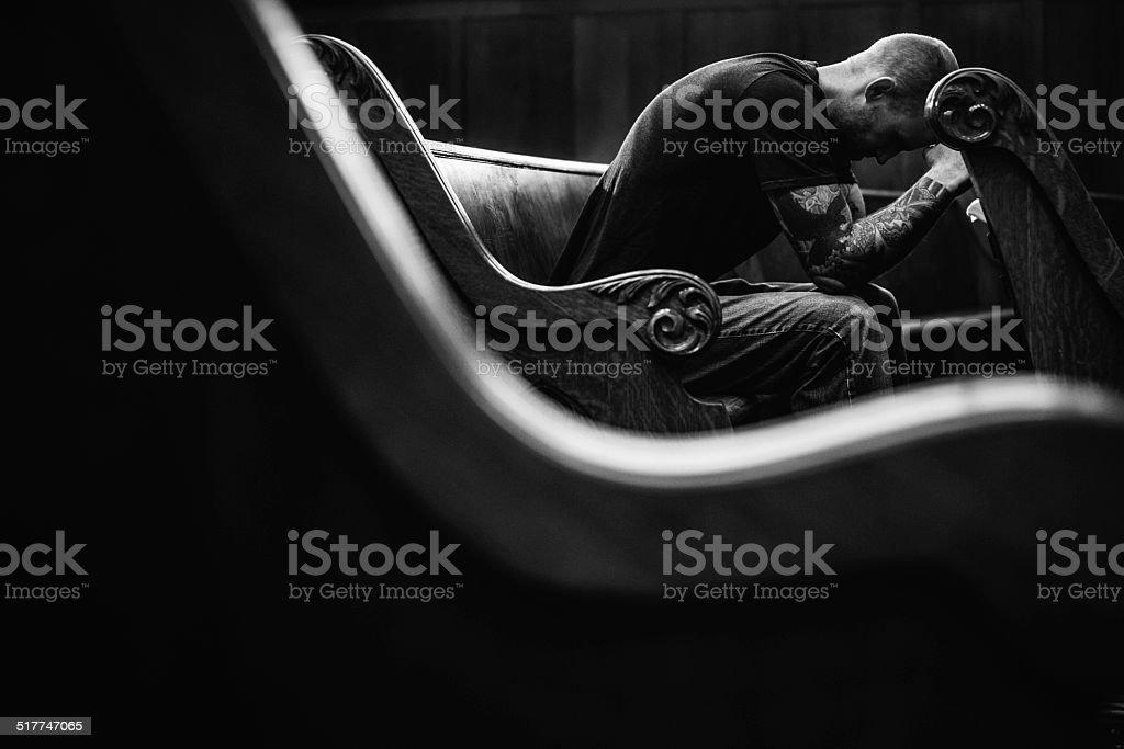 Man Praying in Church stock photo