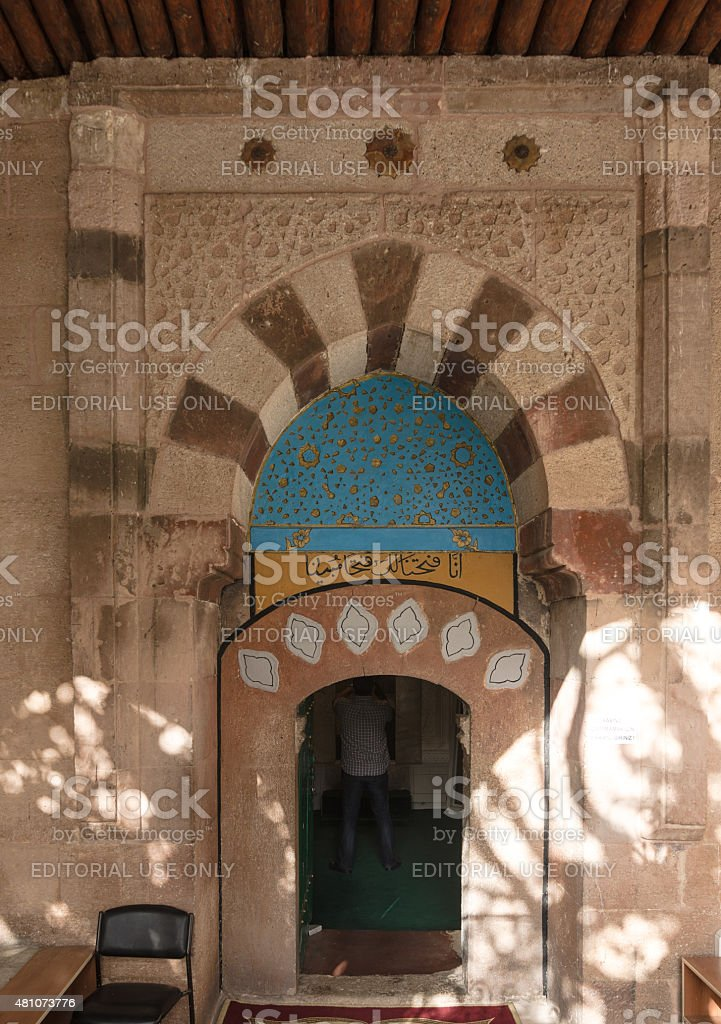 Man praying inside the courtyard of theHaji Bektash Veli Tomb stock photo