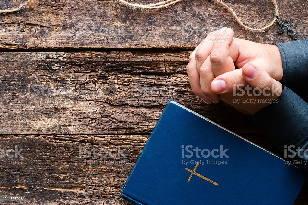 man praying next to the bible and cross mockup stock photo