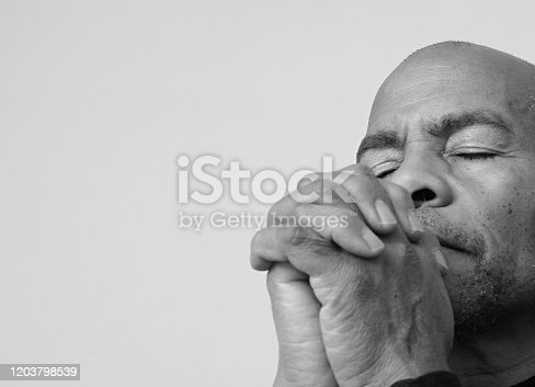 istock man praying to god 1203798539