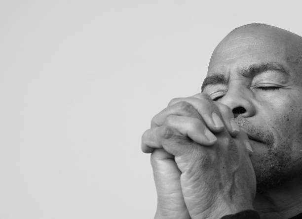 человек молится богу - white background стоковые фото и изображения