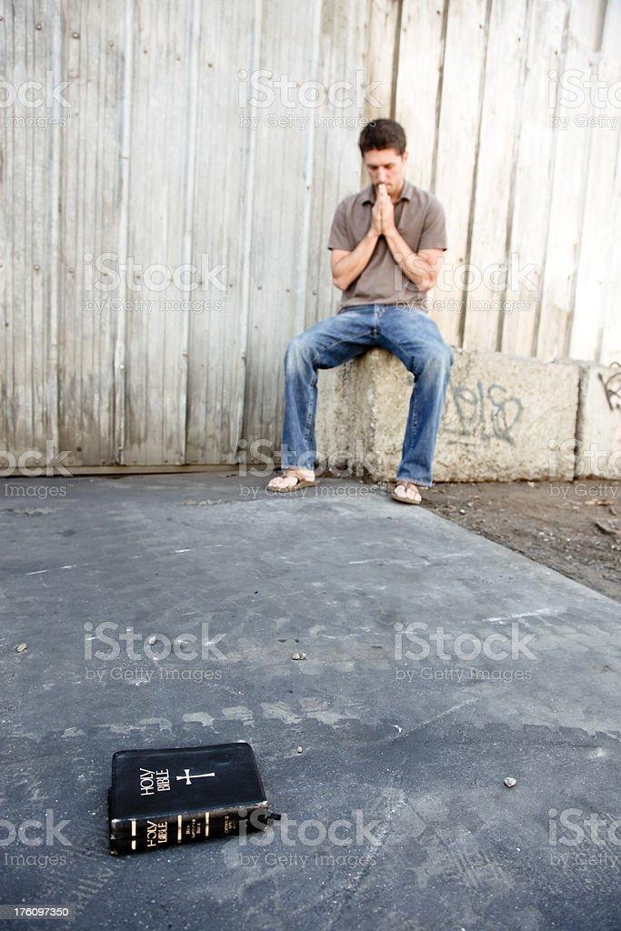 Man praying with Bible stock photo