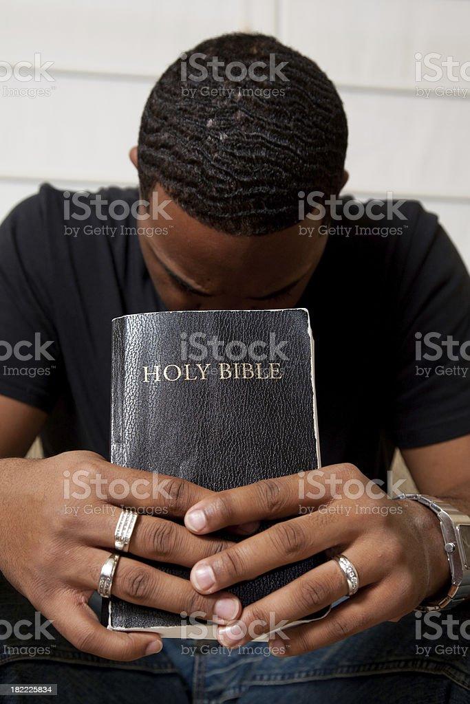 Man Praying with his Bible royalty-free stock photo